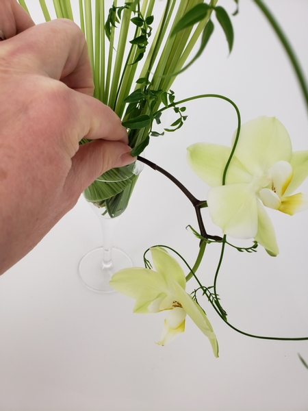 Add in the orchids to cascade out of the armature