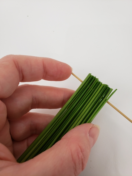 Simply move the grass to the reed end as you add new blades