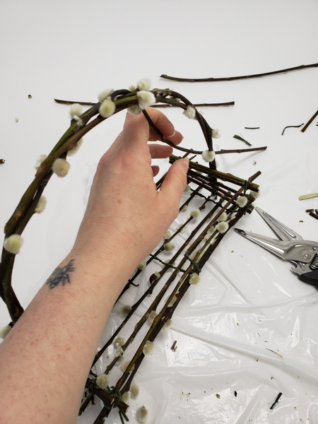 Tucking the ends into the twigs to secure