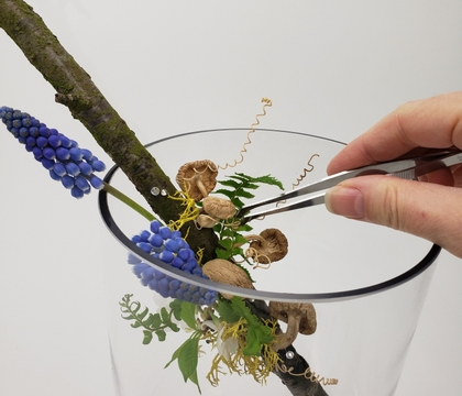 Using the new growth on blossom branches as a base for a woodland design