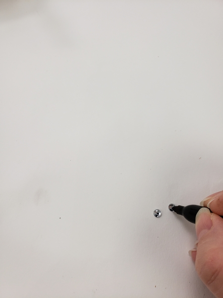 Use a marker to draw eyes on shiny crystals