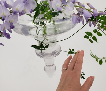 Sea glass counter weights to keep leaning top heavy stems from tipping