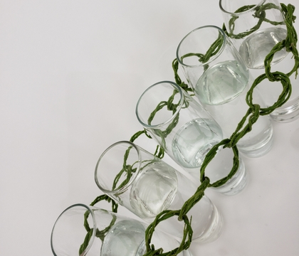 Craft a wreath chain to link a few bud vases together
