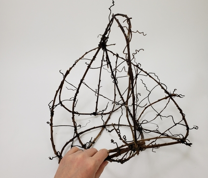 A quick and easy way to Craft a Twig Basket Using Wire Tendrils